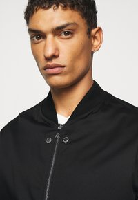 Neil Barrett - TRAVEL SLIM BOMBER - Bomber Jacket - black/natural - 3