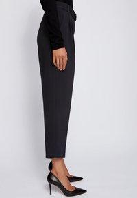 BOSS - TAPIA - Trousers - black - 3