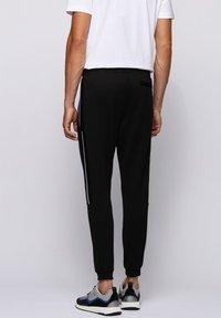BOSS - HADIKO - Pantaloni sportivi - black - 2