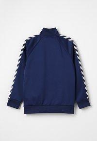 Hummel - HMLKICK - Training jacket - black iris - 1