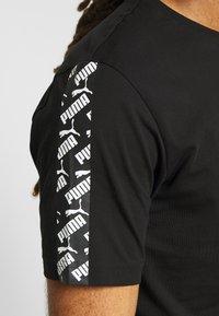 Puma - AMPLIFIED TEE - T-shirt imprimé - black - 5