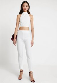 Club L London - GIRL BOSS TROUSERS - Leggings - white - 1