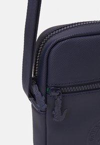 Lacoste Sport - VERTICAL CAMERA BAG - Across body bag - marine - 3