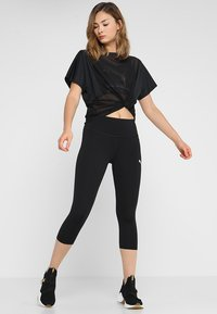 Puma - ACTIVE  - 3/4 sports trousers - puma black - 1