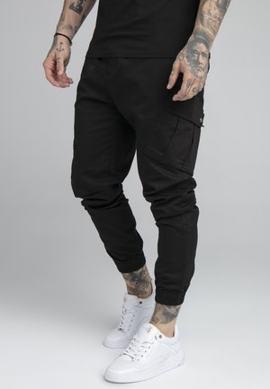 FITTED CUFF PANTS - Reisitaskuhousut - black