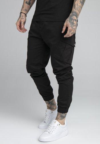 FITTED CUFF PANTS - Reisitaskuhousut - black