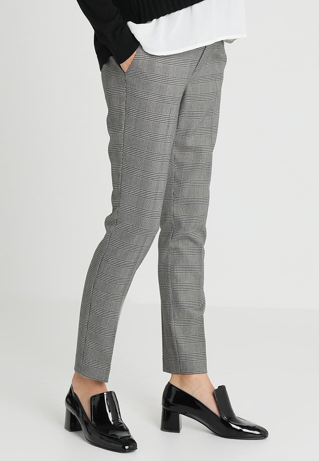 HARRY - Trousers - black/white