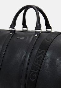 Guess - SCALA UNISEX - Weekend bag - black - 3