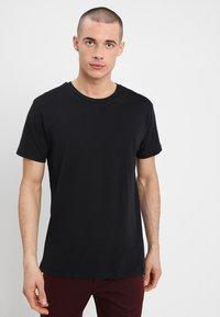Mads Nørgaard - FAVORITE THOR - Basic T-shirt - black - 0