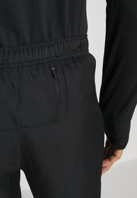 Nike Performance - ESSENTIAL PANT - Tracksuit bottoms - black/particle grey - 4
