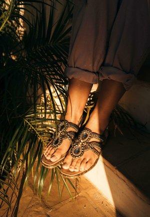 ZULIKA - T-bar sandals - gold