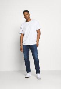 Diesel - D-FINING - Jeans straight leg - dark blue - 1