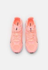 Puma - ULTRARIDE - Neutral running shoes - elektro peach/black/white - 3