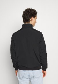 Tommy Jeans - ESSENTIAL PADDED JACKET - Light jacket - black