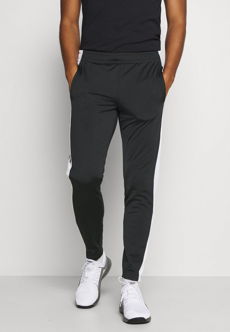 Reebok - VECTOR TRACK PANT - Pantalon de survêtement - black