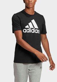 adidas Performance - ESSENTIALS BIG LOGO T-SHIRT - Print T-shirt - black - 3