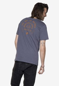 Protest - T-shirt print - mottled dark blue - 1