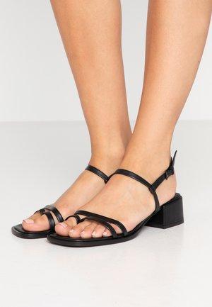 TESSA - T-bar sandals - black