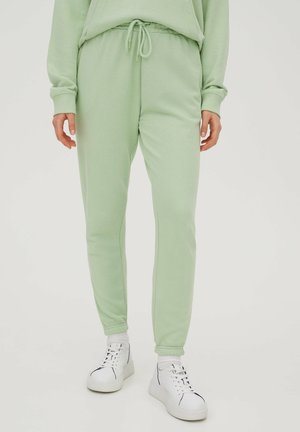 Tracksuit bottoms - mottled light green