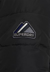 Superdry - SPORTS PUFFER - Winter jacket - black - 7