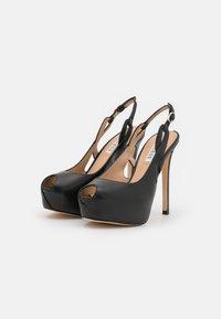 Guess - GINNIA - Platform heels - black - 2