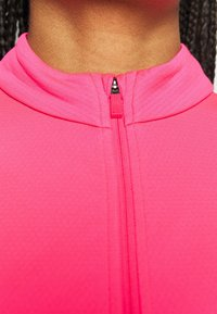 Nike Golf - veste en sweat zippée - hyper pink