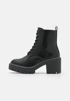 ACER - Platform ankle boots - black paris