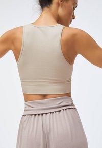OYSHO - Light support sports bra - beige - 5