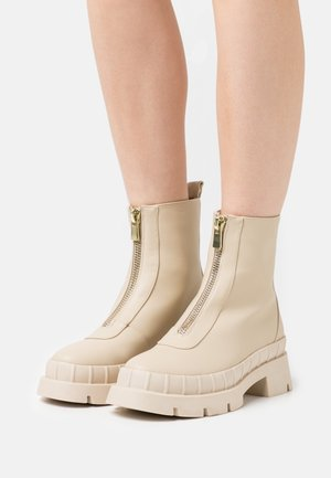 ANNYA - Platform ankle boots - offwhite