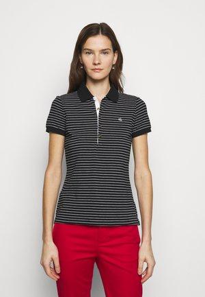 ATHLEISURE - Polo shirt - black/white