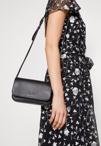 Coccinelle - ANNETTA MINI BAG - Across body bag - noir - 1
