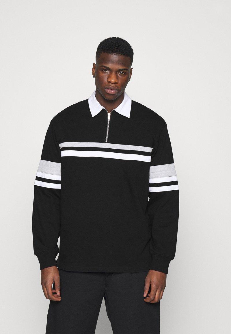 Weekday - OMAR HALFZIP - Polo shirt - black