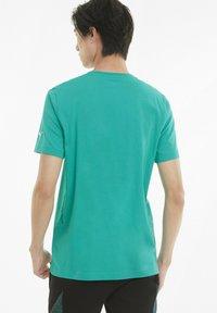 Puma - T-shirt imprimé - spectra green - 2