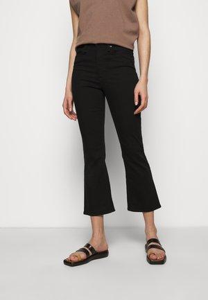 NINA  - Flared Jeans - black