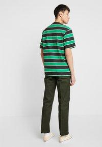 Dickies - 873 SLIM STRAIGHT WORK PANT - Trousers - olive green - 2