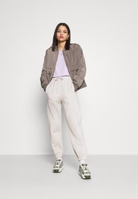 Topshop - YANKEE QUILTED - Tracksuit bottoms - grey - 1