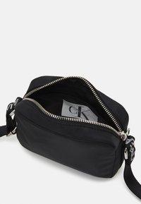 Calvin Klein Jeans - LOGO CROSS BODY BAG - Taška spříčným popruhem - black - 2