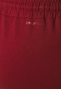 ONLY Play - ONPLOUNGE PANTS CURVY - Tracksuit bottoms - sun dried tomato - 2