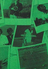 Lacoste LIVE - UNISEX - Polotričko - malachite/black - 2