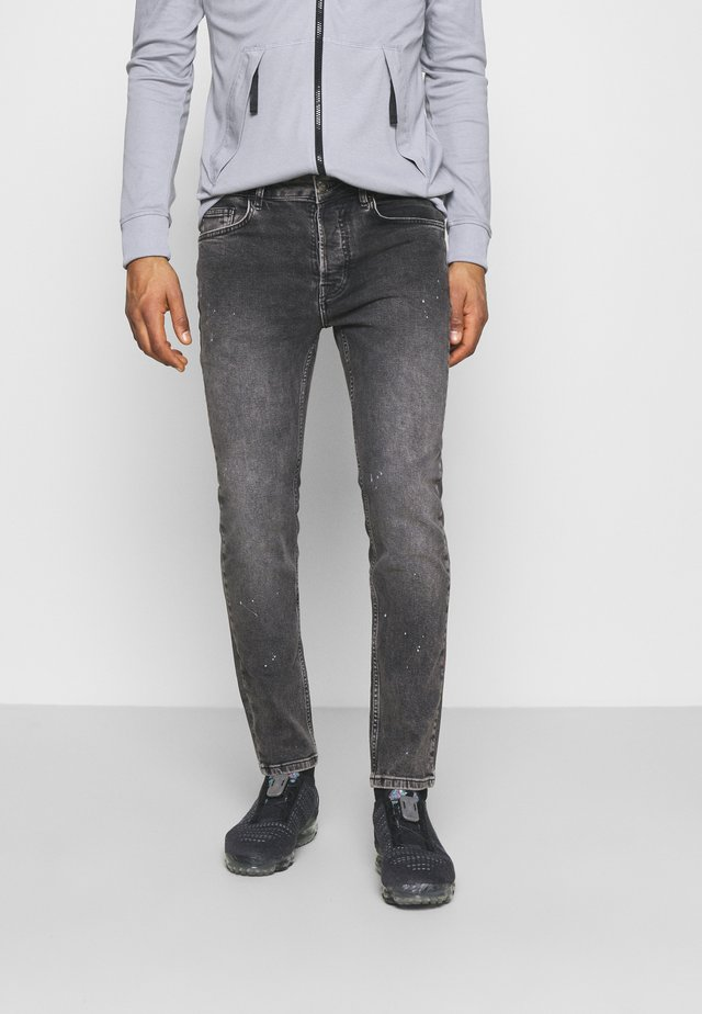 Slim fit jeans - mid grey paint splatter