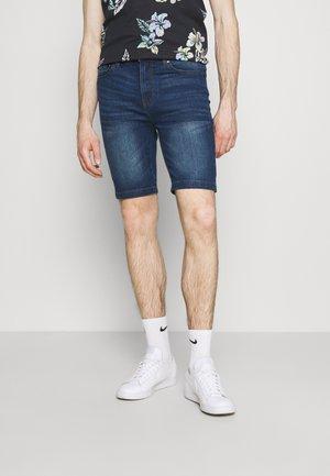 Denim shorts - mid wash