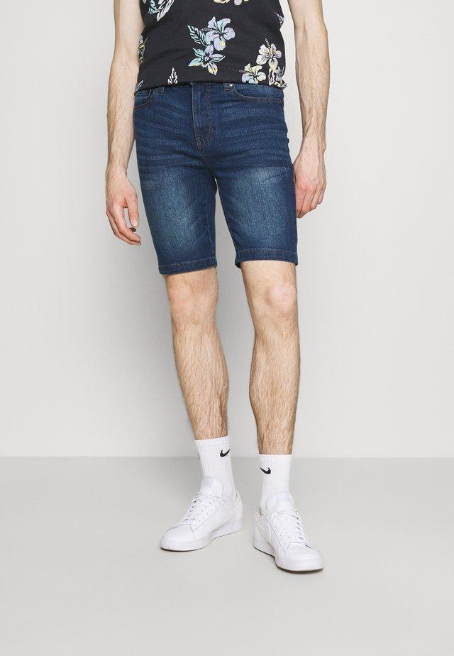 Shorts vaqueros - mid wash