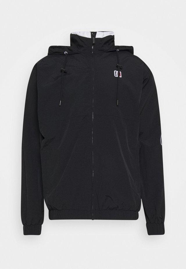 SIGNATURE WINDRUNNER - Summer jacket - black