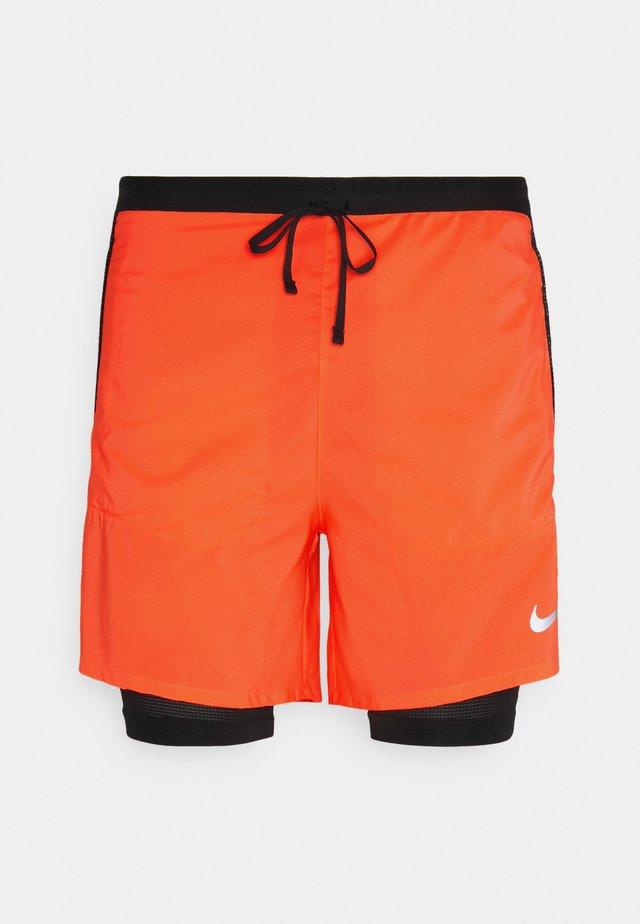 Pantaloncini sportivi - bright mango/black/silver