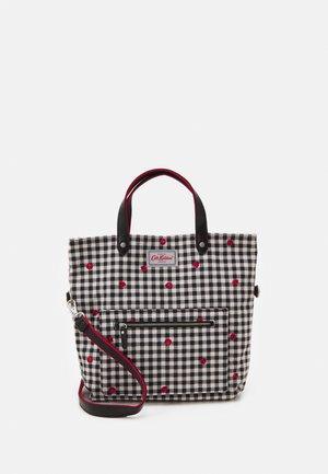 REVERSIBLE CROSS BODY - Handbag - stone charcoal
