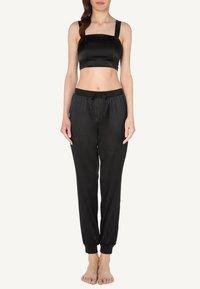 Intimissimi - AUS SEIDE UND SPITZE - Pyjama top - black - 0