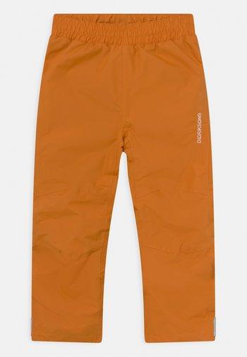 NOBI KIDS UNISEX - Rain trousers - burnt glow