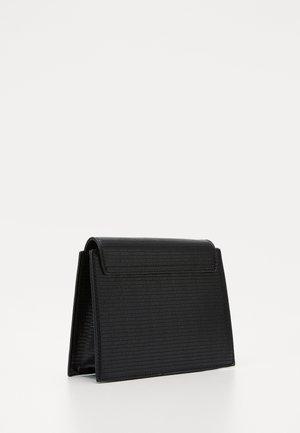 PCHOLLYA CROSS BODY KEY - Across body bag - black