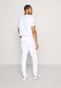 Topman - PRIMARY PIPED - Tracksuit bottoms - white - 2