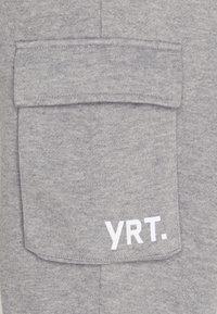 YOURTURN - UNISEX - Tracksuit bottoms - mottled light grey - 2